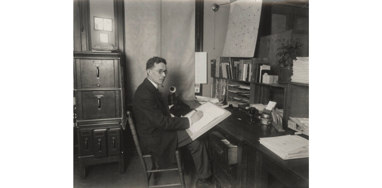 Paul M. Paine at a Writing Desk