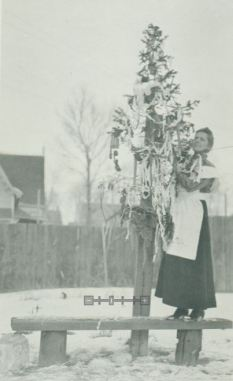Dr. Hebard decorating a Christmas tree in her backyard in 1917, Photo File: Grace R. Hebard, American Heritage Center, University of Wyoming